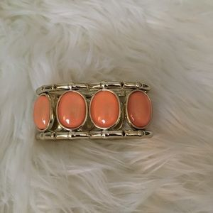 Stretchy golden and salmon colored bracelet